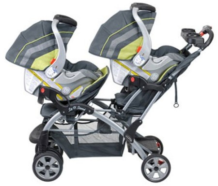 Baby Trend Sit N Stand Double Stroller with two infant car seats