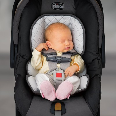 Chicco KeyFit 30 with newborn pillow for head and body support