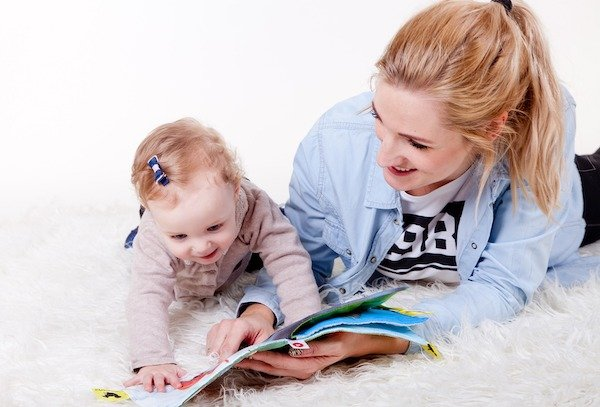 To make the tummy time more interesting for the baby place a toy or book in front of the baby