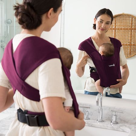 Ergobaby Embrace has wide fabric X-crossed straps that look like a wrap
