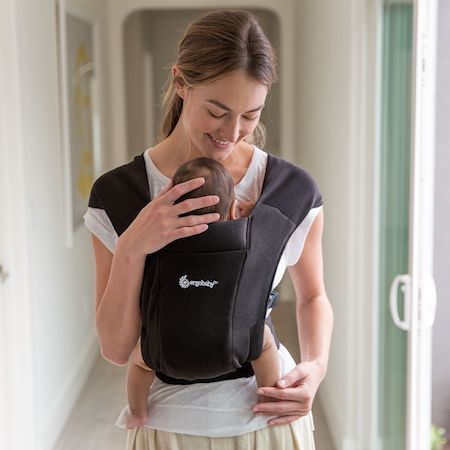 Ergobaby Embrace keeps baby in ergonomic frog position that is safe for their hips