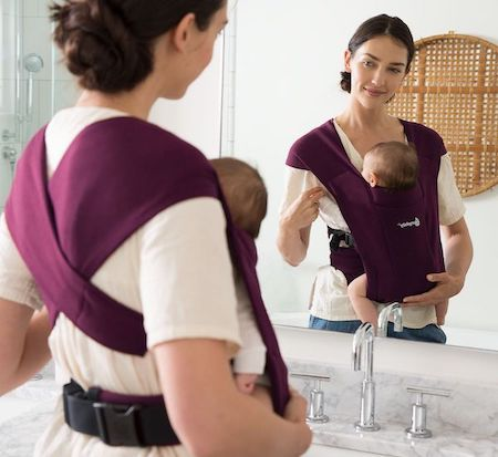 Ergobaby Embrace has X-crossed fabric shoulder straps that look like a wrap