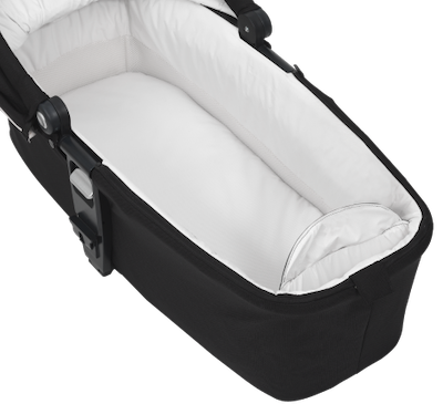 Nuna MIXX series bassinet has a storage compartment and machine-washable mattress cover and liners