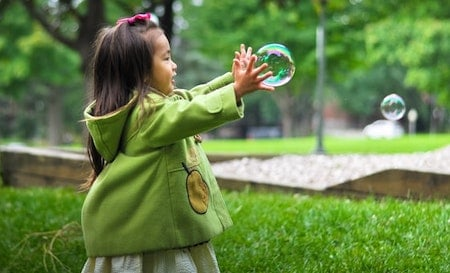 Catching soap bubbles - practicing fine motor skills