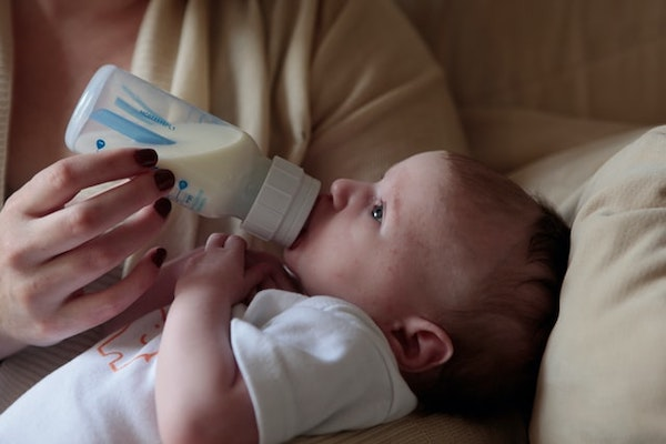 Infant bottle feeding with breast milk