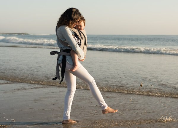 Baby carrier is often better solution than a stroller for going to the beach