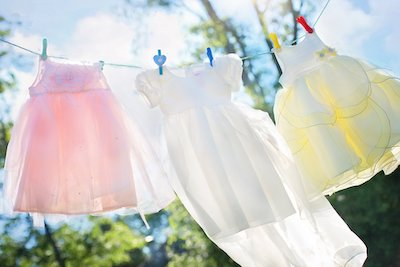If you want to get baby poo stains out of baby clothes it's best to dryy them in the sun than use a dryer