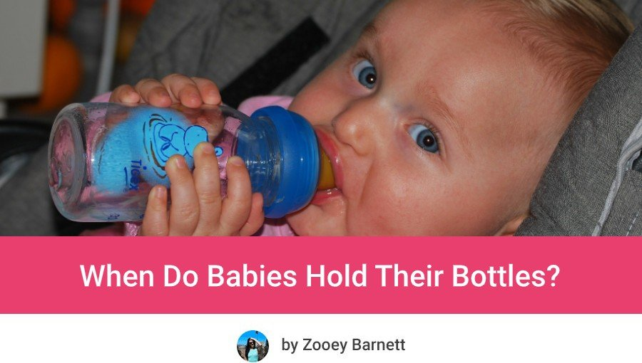 what age does babies hold their bottle